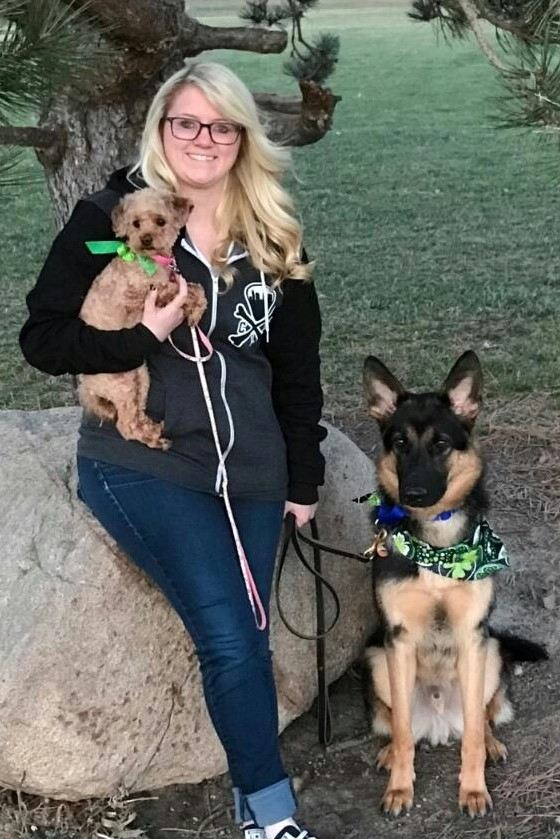 Taylor Urbanowski with Lulu and Moose in the park