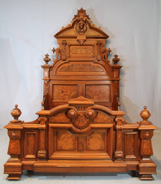 Oversized 19th century burl walnut Victorian bed attributed to Thomas Brooks.