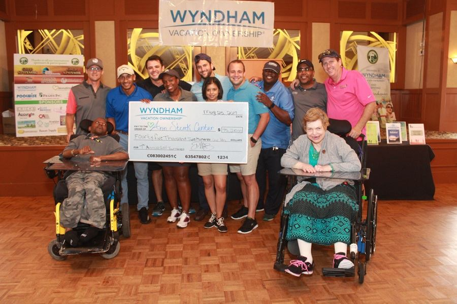 Wyndham Vacation Ownership & Ann Storck Center employees with two individuals.