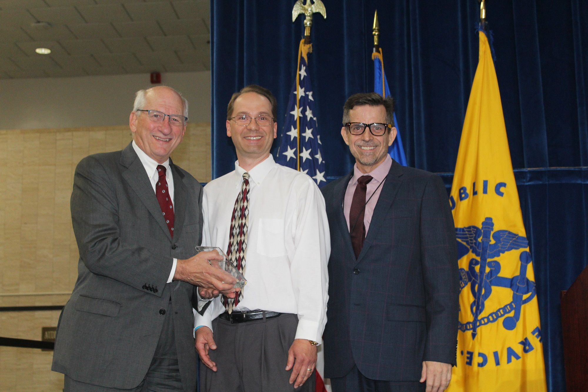 Michael Suralik (center) with NVPO Officials