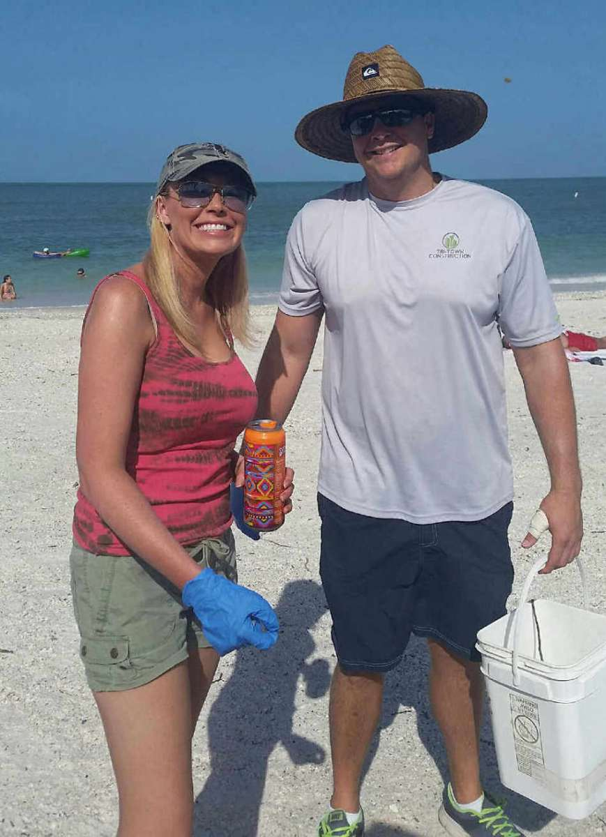 Natasha Smith and Marc Devisse clean up Bonita Beach