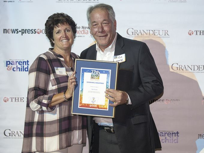 Nancy Solliday presents award to Goodwill CEO Rick Evanchyk