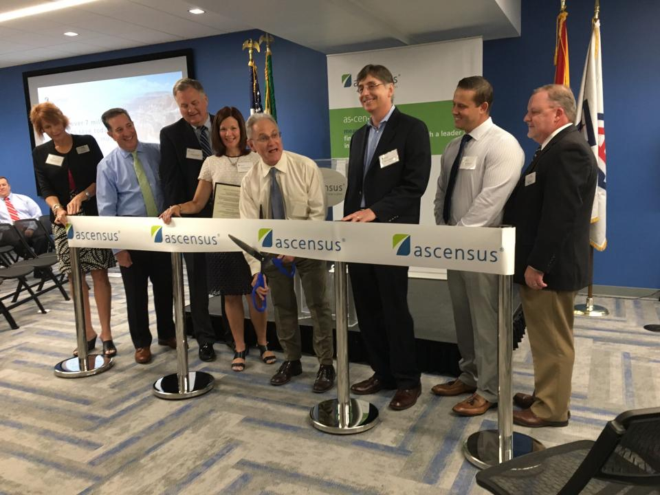 Ascensus' executive leaders and Tucson Mayor Jonathan Rothschild cut the ribbon.
