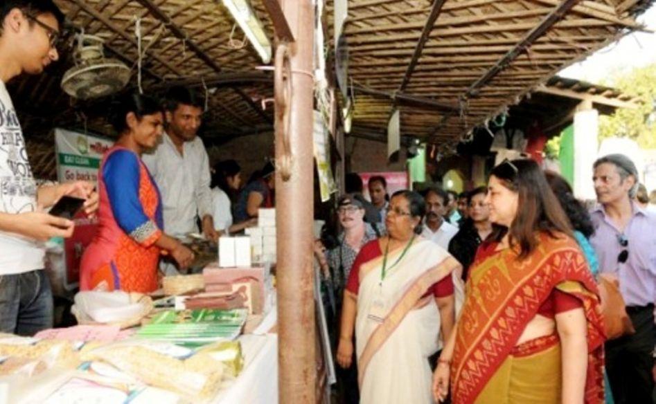 Hon'ble Minister visiting the stalls at Women of I