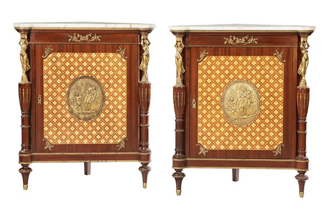 Pair of late 19th century French Belle Epoque Louis XVI-style corner cabinets.