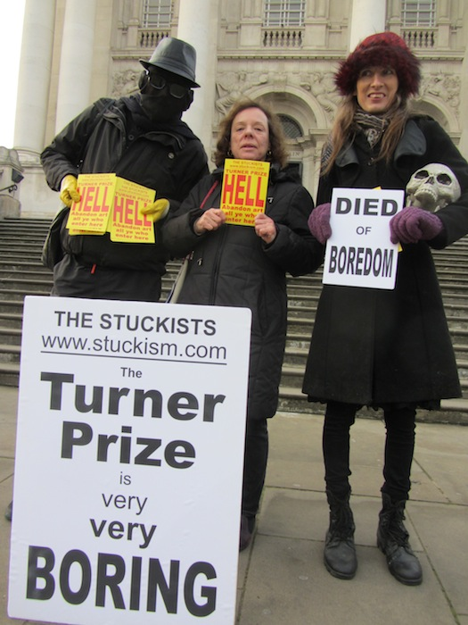 Anon, Jane Kelly, and Remy Noe protest outside Tate Gallery in London, 2016.