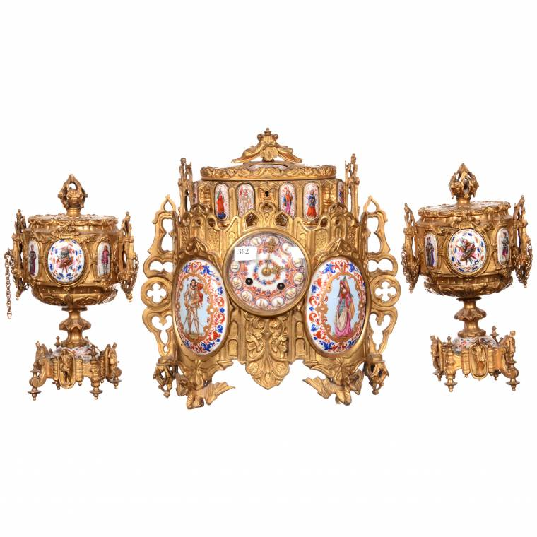 Early French Sevres 3-piece ormolu clock set with clock and two matching urns.