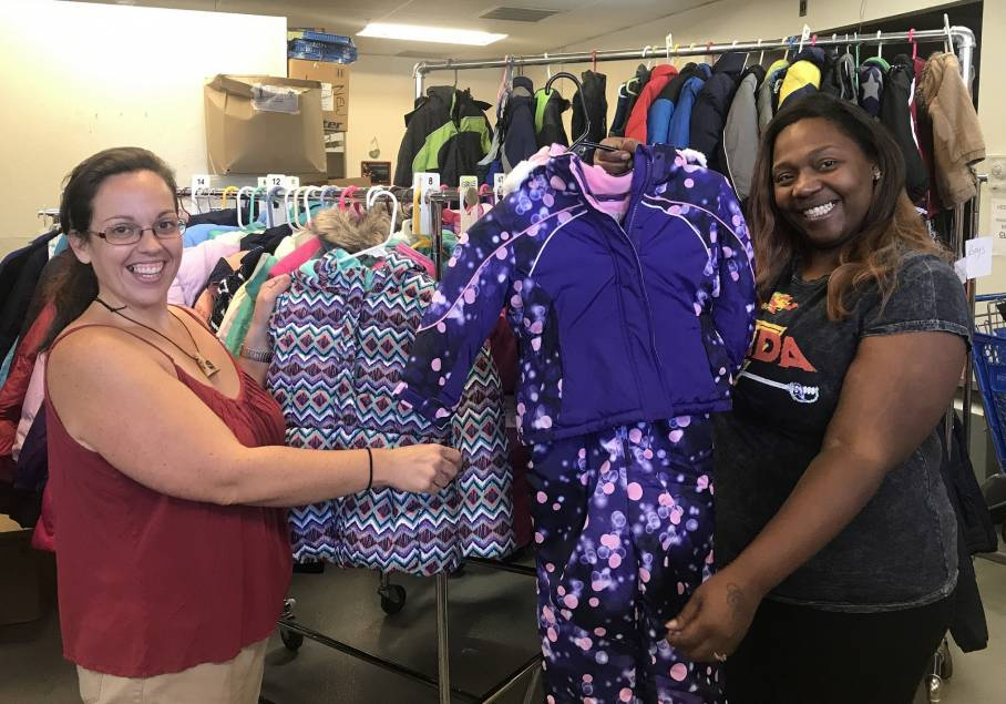 Acts 4 Ministry Volunteers Lucy Robinson and Melissa DiLeo sort winter coats