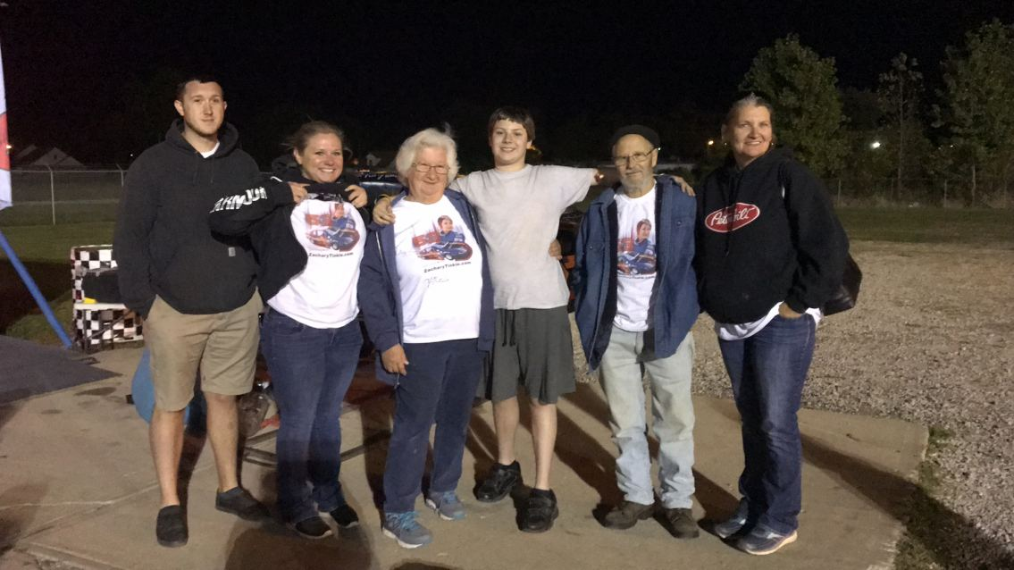 Zachary Tinkle with family in the pits after crash at Anderson Speedway