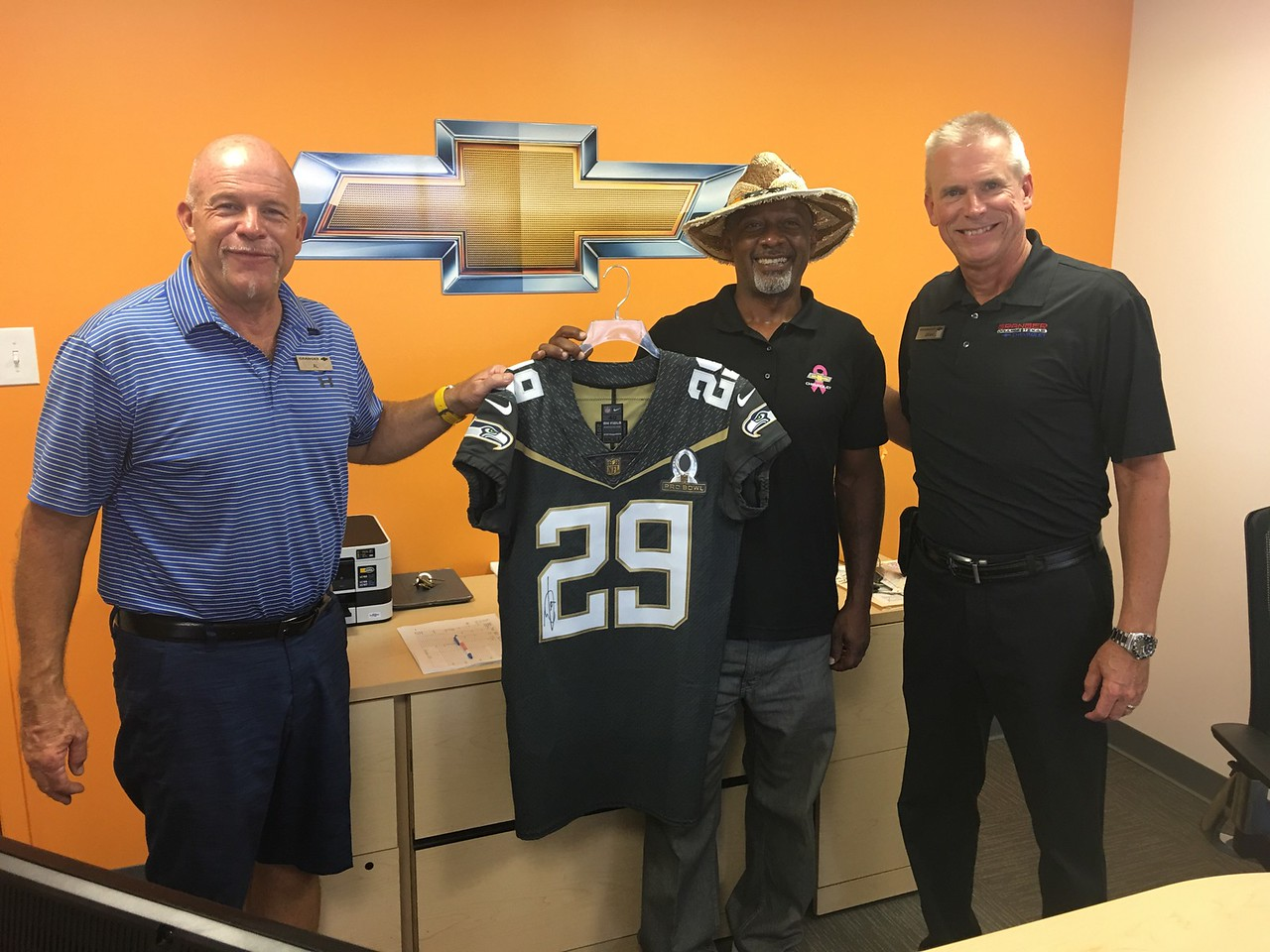 Granger Chevrolet presents Jimmy Britt Chevrolet with an Earl Thomas jersey