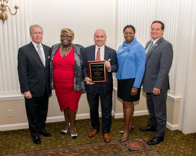 Center: 2017 Commercial Real Estate Humanitarian Award Honoree George Sowa