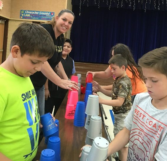 Desert Vista students practice for sport stacking record.