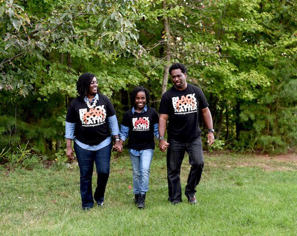 MahoganyBooks owners Ramunda and Derrick Young with their daughter.