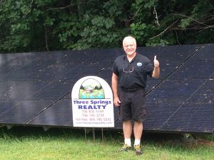 Broker/owner Dan Easton and the solar panels he relies on for alternative energy