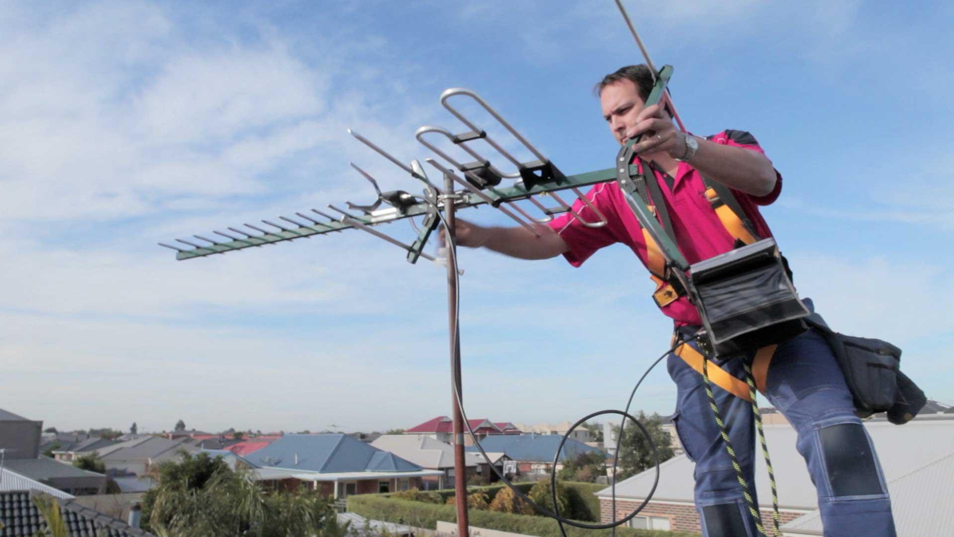Man installing TV aerial