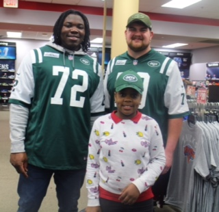 NYJets Brandon Shell and Brent Qvale with Dionyae Mitchell, from Brooklyn's BCS
