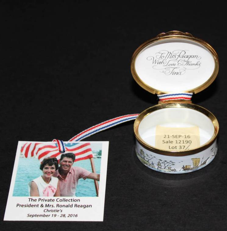 Porcelain enameled pillbox gifted and inscribed to Nancy Reagan by Tina Sinatra.