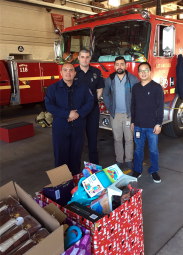 Axiomtek employees present their donation to the LA County Fire Dept Station 118