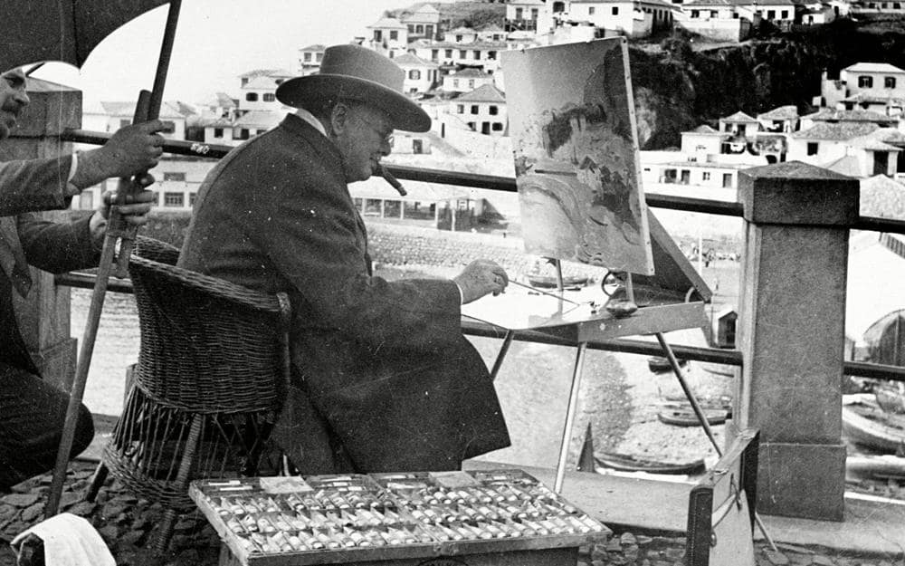 Winston Churchill painting on holiday in Madeira. Credit: (c) 1949 Rex Features