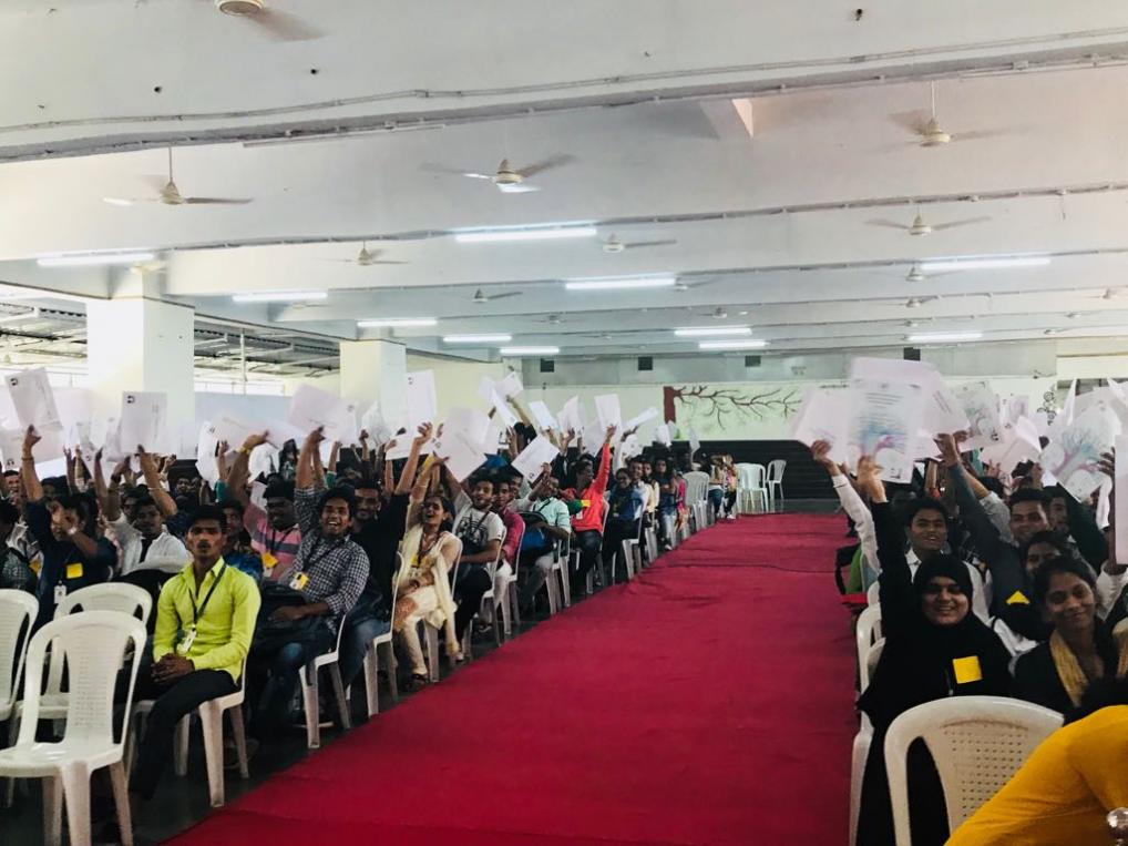 Students of Sree Narayana Guru College of Commerce proudly wave Certificates