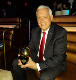 John Costanzo holding Eggie Award