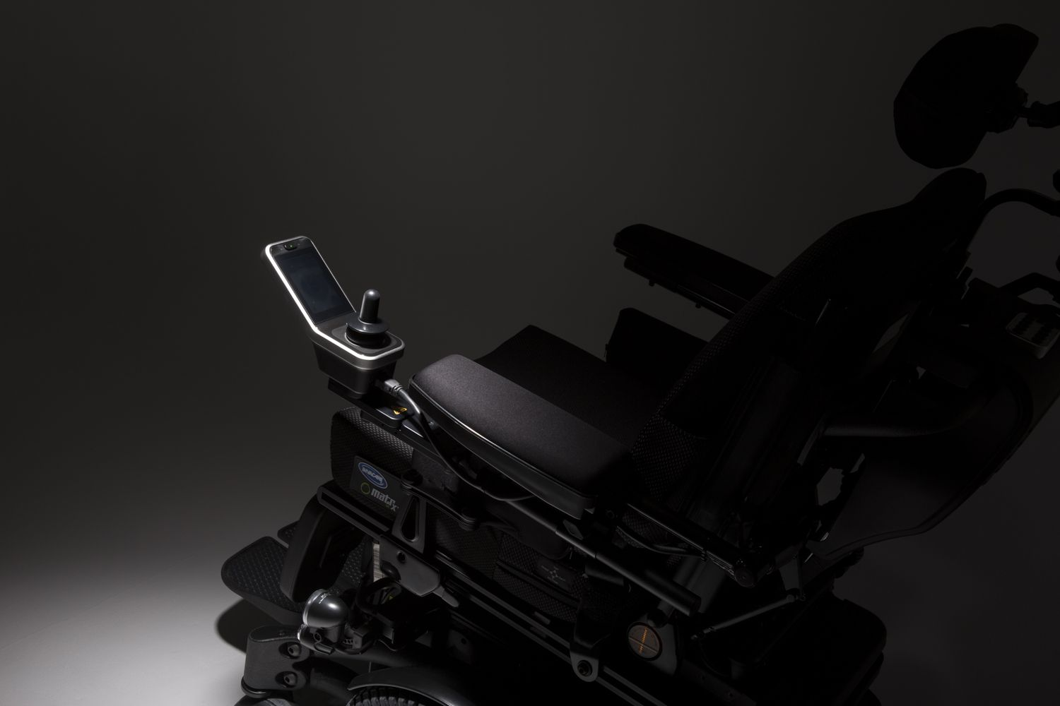 Invacare LiNX REM400 Touch Screen Remote on an Invacare Powerchair