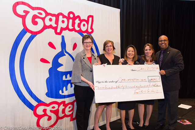Susie Sylvester Duggal and Liz Gavin Pao presented Cornerstones with the check