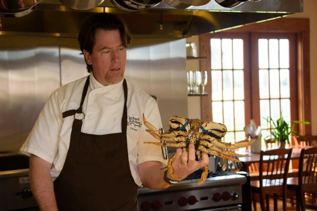 Chef Vincent Natress handles a crab
