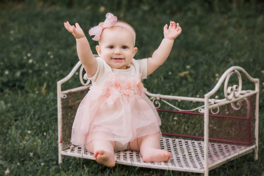 MaeLi Rose Floral Patch Skirted Onesie