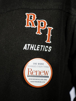 "One of nearly 1000 ""RENEW"" buttons distributed to students & alumni at the game."