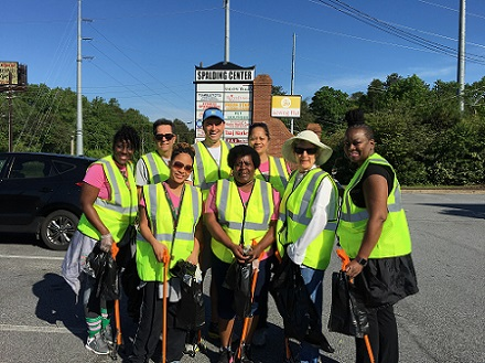 A Smiling Group of GAC Participants Gets Set to Cleanup their Community