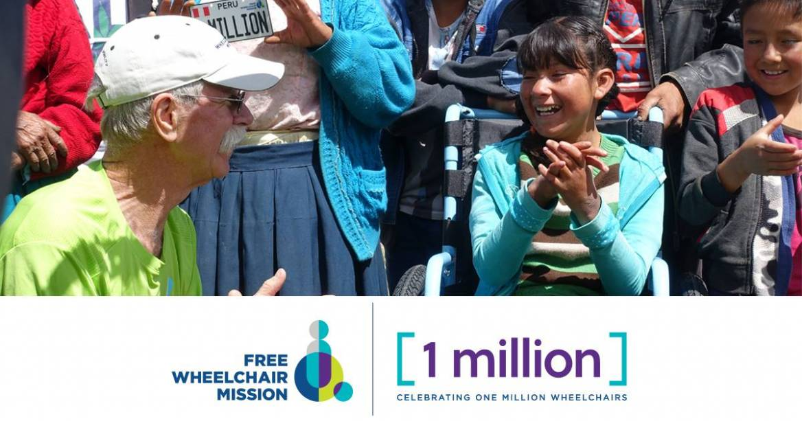 Flor receiving 1 millionth wheelchair with Don