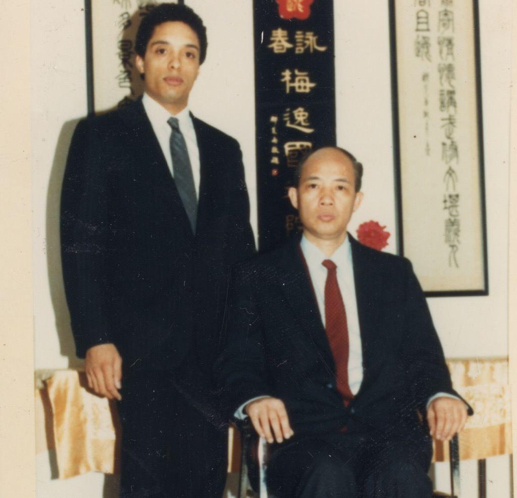 Moy Yat sitting Moy Tung standing formal