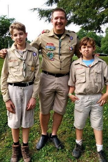 Ryan pictured with Son's Isaac & Max at first year of Boy Scout Summer Camp
