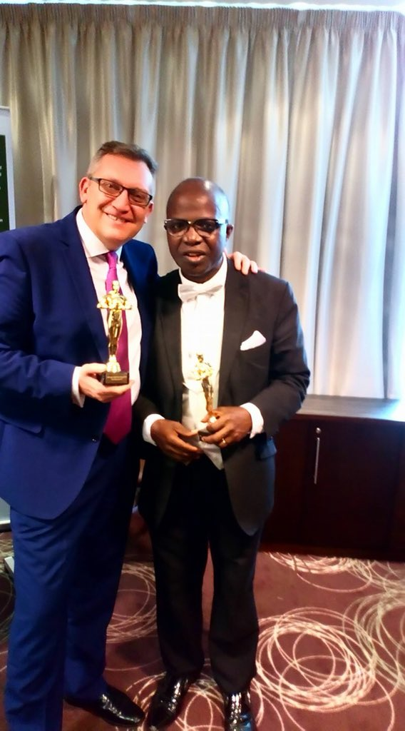 Professor Chris Imafidon gets authentic leadership award flanked by C. Bradley