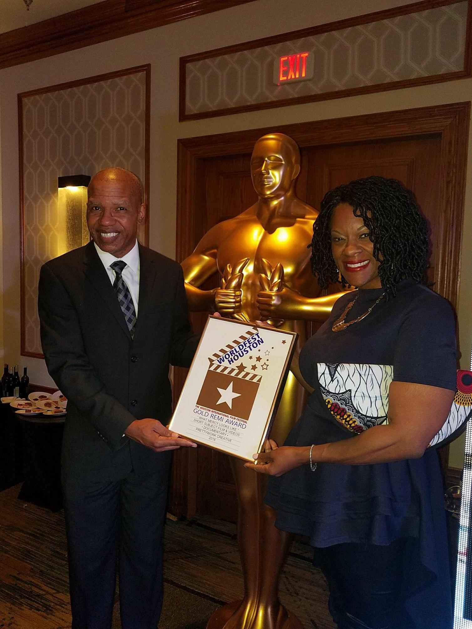 Lisa N. and Elgin Alexander receive a Gold Remi at the WorldFest Film Festival.