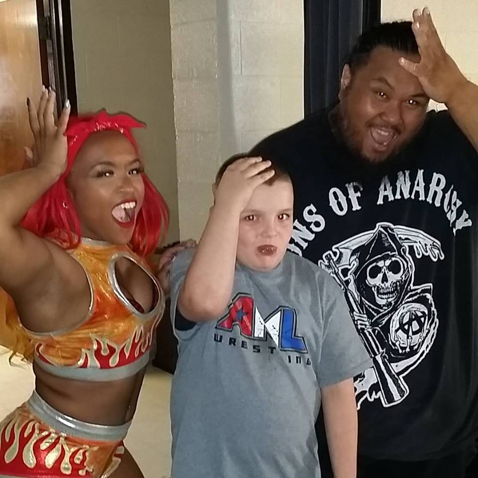 Kiera Hogan and Fallah Bahh w/ a Fan