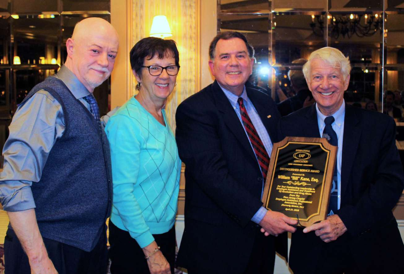 William Kane accepts award from Kevin O'Neil,& congratulations from NJLAP staff.