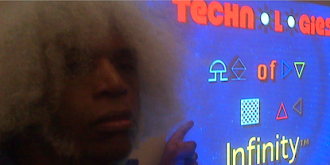 Marshall Barnes shows the Technologies of Infinity logo at MarCon