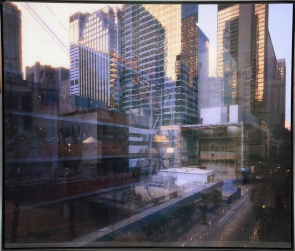 One of several Michael Wesely color print photos housed in steel frames.