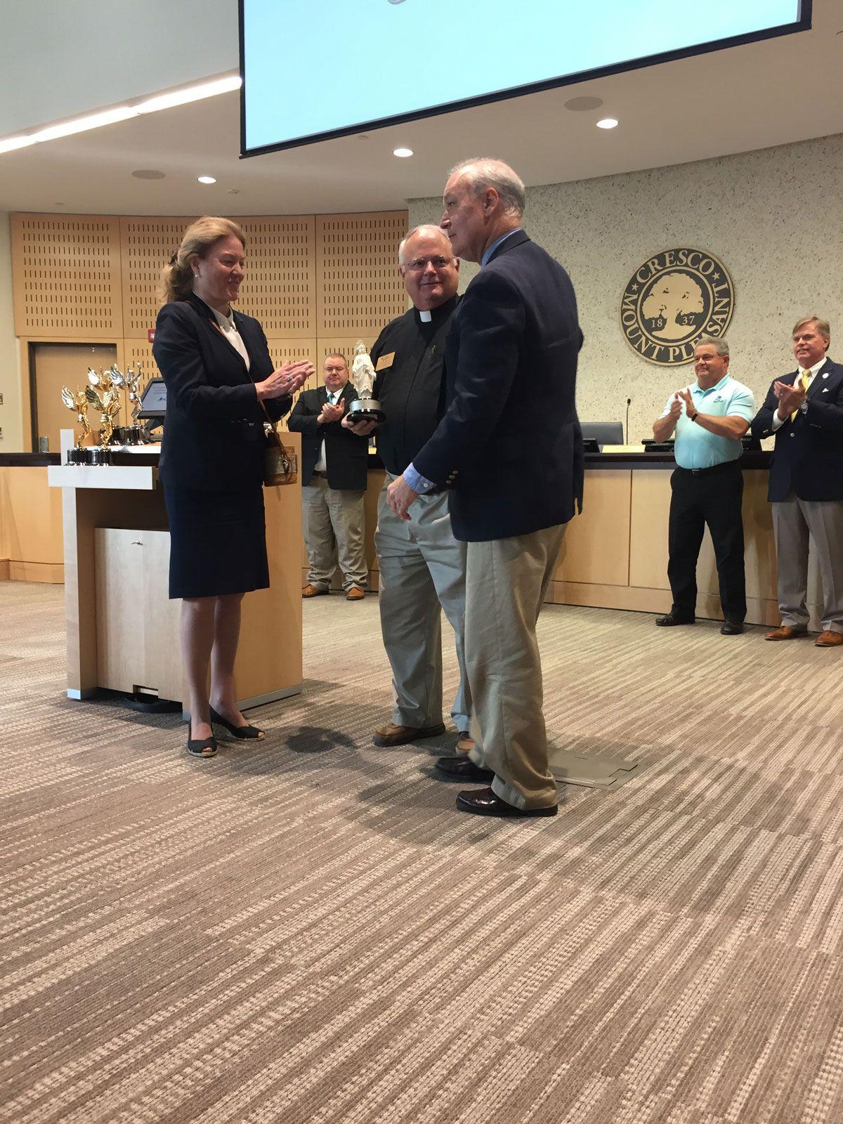 Dr. Wyatt presents award to Rev. Dewey, Mt. Pleasant Mayor W. Haynie presiding