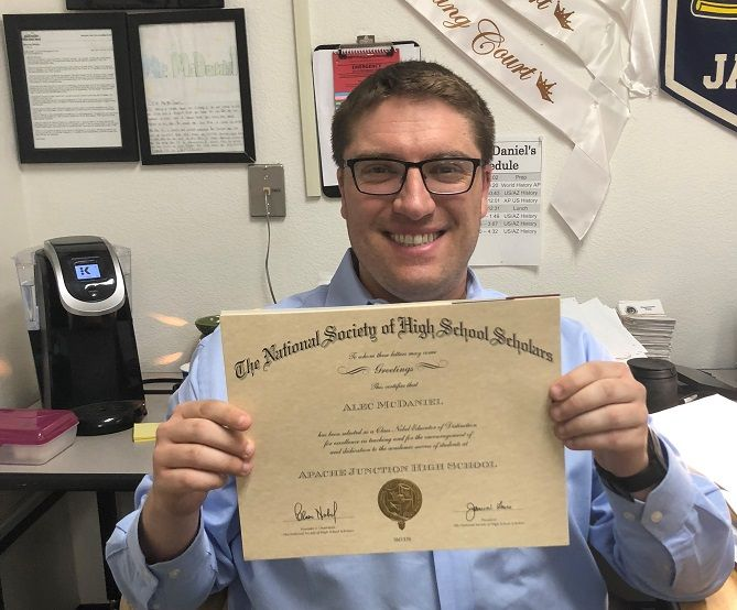 Alec McDaniel shows off his certificate.