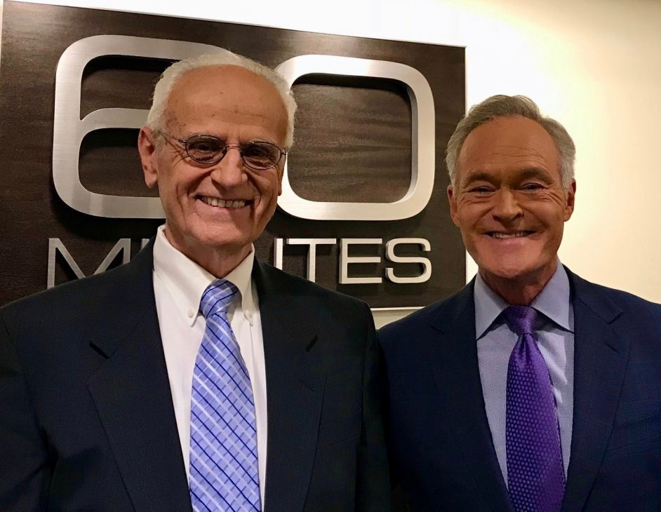 Dr. Duane Priddy (left) interviewed by Scott Pelley (right)
