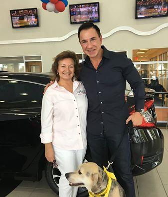 Anna Cooke and John Marazzi with rescue dog Zeus