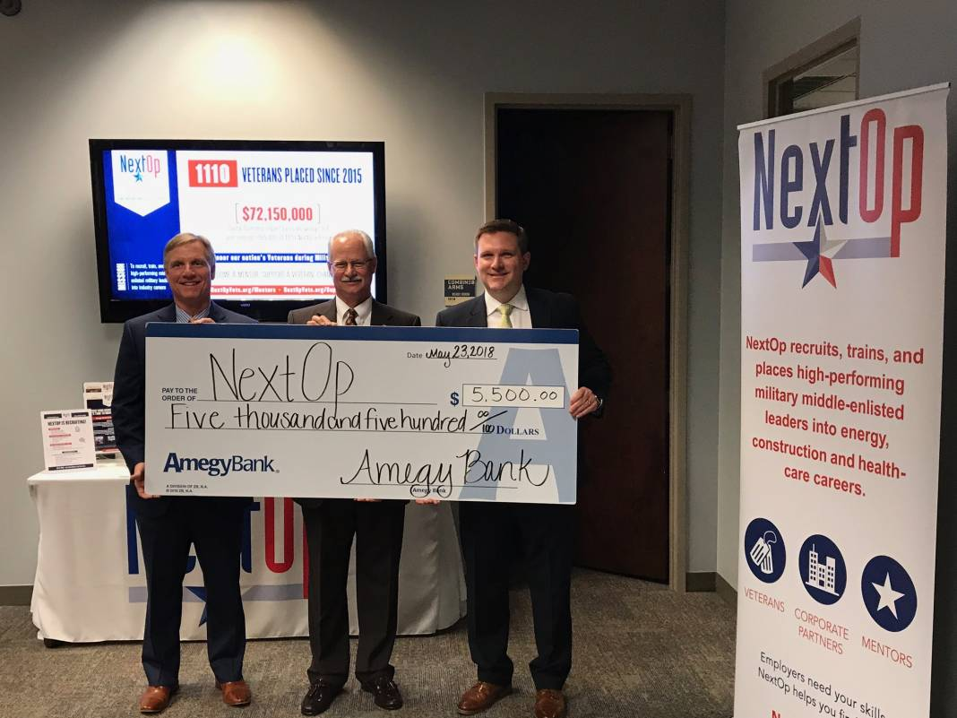 Executive Director, John Boerstler, accepting the donation on behalf of NextOp