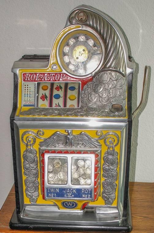 Mid-1930s Watling three-reel 5-cent slot machine, a Rol-a-Top model ($3,250).