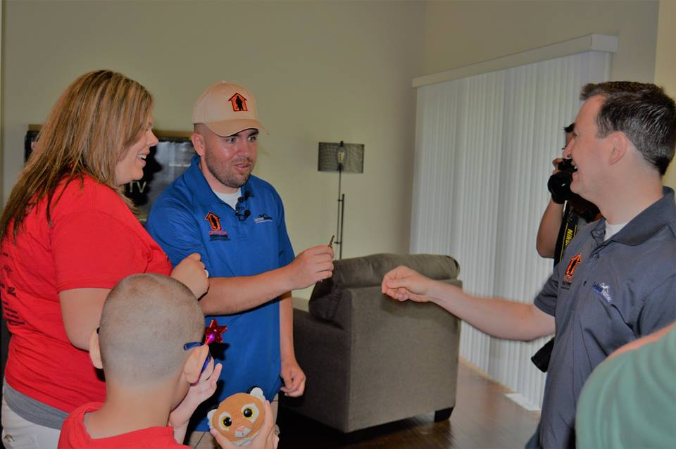 David Belman handing U.S Army Staff Sergeant, Joe Davis the keys to his new home