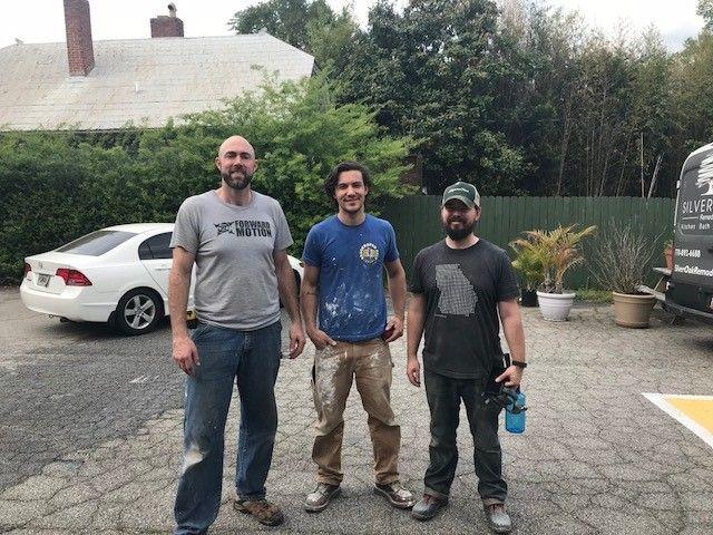 HomeAid volunteers Steven Sanders-Myers (L) and crew members.
