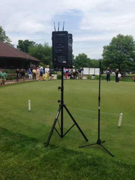 AmpliVox Digital Audio Travel Partner in action at golf outing fundraiser.