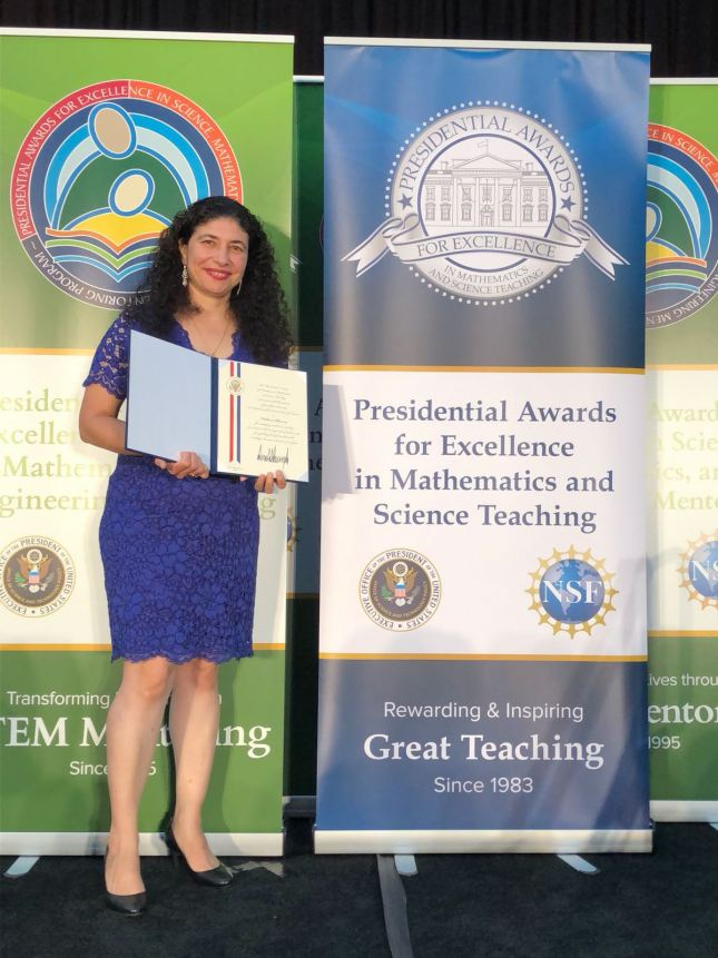 Delara Sharma receiving Presidential Award for Excellence Science Teaching